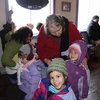 Grandma attempts to warm up the little ones after time out in the cold.