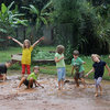 The rainy season slip 'n slide au naturale-- the reason we regularly deworm our children... (our youngest 5 with 2 of their Aussie friends)