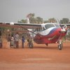 Getting supplies at Yei airstrip brought from Kampala, Uganda via a missionary plane