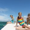 Eva (left, age 11 almost 12), Olivia (center, age 9), & Hazel (just turned 8) enjoying the sun on the Indian Ocean (yes, despite spf 50 sunscreen, we do have sunburns here on the equator)