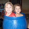 Hazel & Given swimming in the rain collection barrel