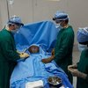 "Praying before (first) surgery in the new ""operating theatre"" (OR), with Dr. Poole and staf"