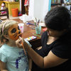 Sophia cleverly uses watercolors to do face painting on siblings — who knew??