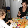 Christina, Elizabeth's brother's wife, playing a game with Winnie