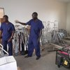 Eva, Frazer & Kamba (our lab techs) amongst supplies in the almost completed hospital ward
