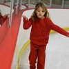 Hazel, tenuously learning how to skate... staying near something stable.  May we be like her- staying connected to the Solid Rock.