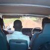 "Praise session (""Our God is a Wonderful God"") in the van... the gospel in song for those along the road, and our escort, to hear!"