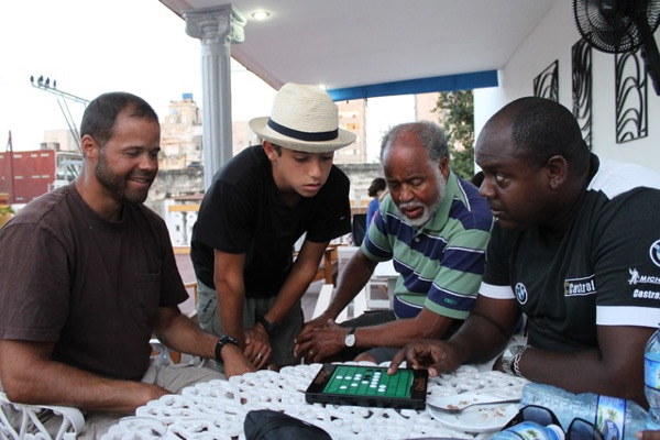 Christopher (Elizabeth's brother), Logan, Orestes (Elizabeth's dad) and Victor, our Cuban cousin playing Othello (family tournament forthcoming!)